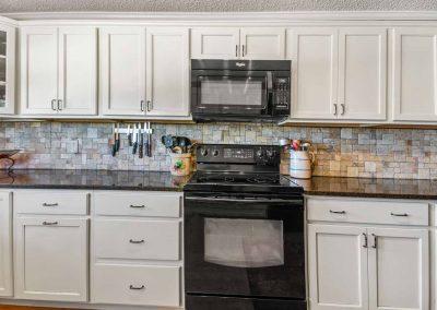 1400 Bayou Drive - White kitchen cabinets